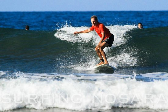 Nosara Tico Surf School : So proud to see Dennis catching those green water waves on his own!