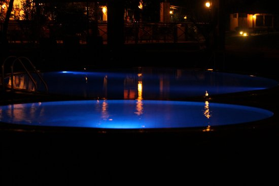 Ashnil Samburu Camp: The swimming pool by night.
