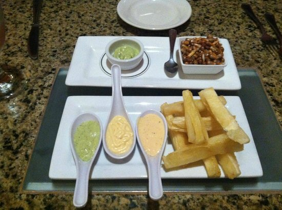INKANTO Authentic Peruvian Cuisine : Yuca appetizer (front) with Cancha (dried corn) (back)