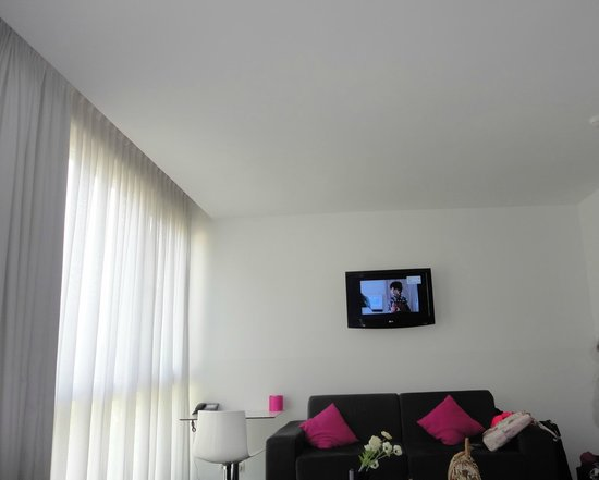 Pantone Hotel: The room had a sofa and a TV on the wall - no channels in English though