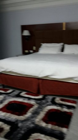 Grand International Hotel : Room bed and furniture
