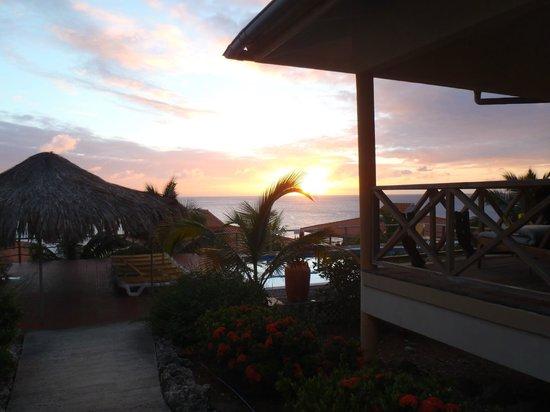 Caribbean Club Bonaire : sunset from the west pool area near villas