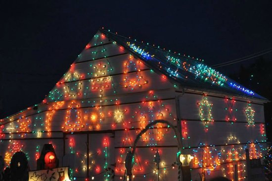 Koziar's Christmas Village: Lights on Barn Building upon Entrance to Village