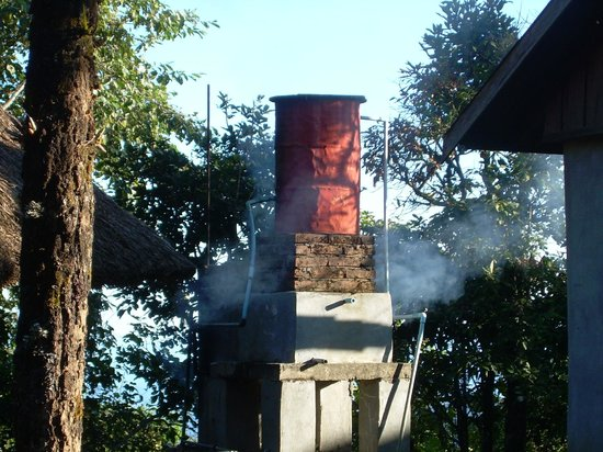 Mountain Oasis Resort (ecological lodges): Firewood to heat water tank