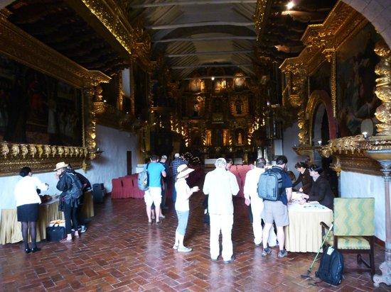 Belmond Hotel Monasterio: Tired travelers being welcomed to Hotel Monasterio