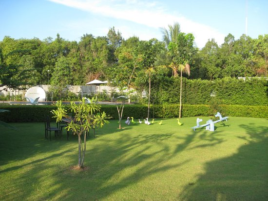 Perennial Resort: Garden with pool area in the rear
