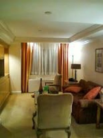 The Michelangelo Hotel: Living room area of suite viewed from opposite end where entrance and wet bar are