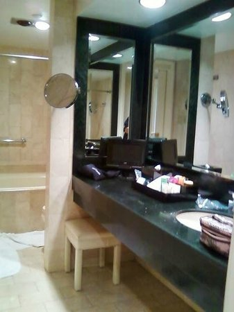The Michelangelo Hotel: Bathroom with large vanity, double headed shower, wall magnifier mirror and tv