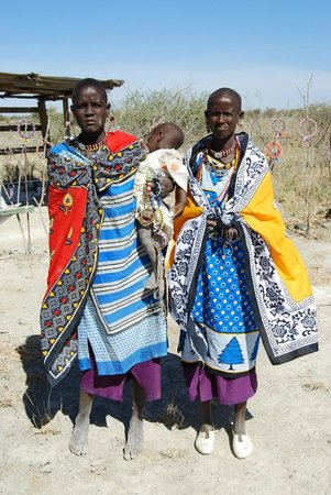 Rift Valley Province, Kenya: Masai women pose for photographs