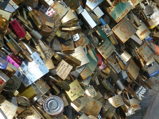 Tours de la Cathedrale Notre-Dame: buy a lock, attach it to the bridge, then throw the key in the Seine