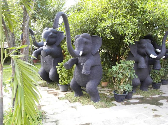 Royal Angkor Resort & Spa: elephant statues by pool and spa building