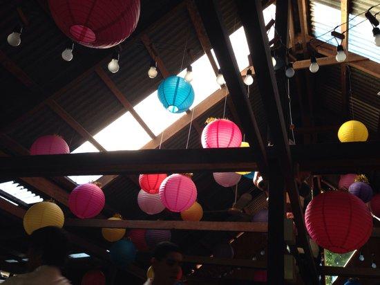 Chubascos: Festive lanterns added cheerfulness to the dark rustic indoor dining room
