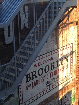 Wythe Hotel: Sun rising on Welcome to Brooklyn sign