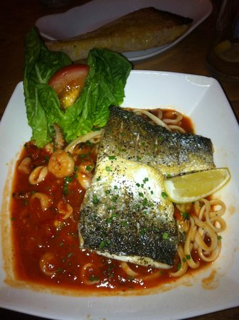 The Old Farmhouse: Baked Sea Bass fillets with spicy tomato seafood linguine