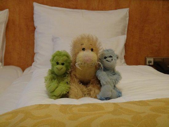 Opera Suites: Winkin, Blinkin, & Nod enjoying the luxurious feather bedding