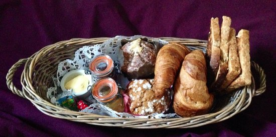 Five Hotel: Croissants, toast, jam, and muffin selection