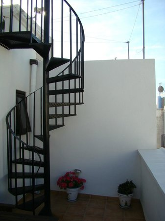 Dios Esta Bien: Stairs to the roof terrace