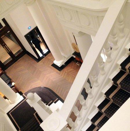 Hotel Granvia: looking toward registration area and person walking into elevator