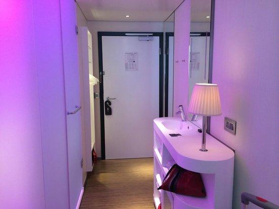 citizenM London Bankside: bathroom area - toilet & shower on left, sink & vanity on right