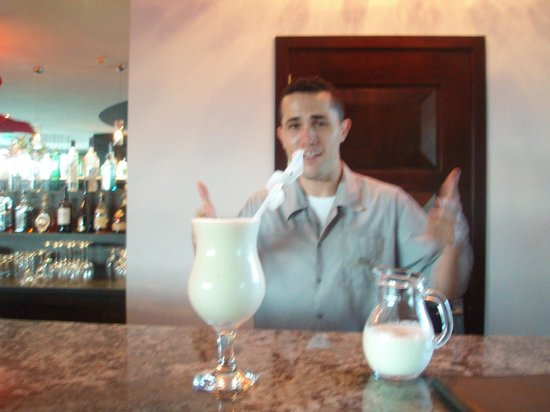 The Royal Corin Thermal Water Spa & Resort: Mauricio serving a world-class Pina Coloda!