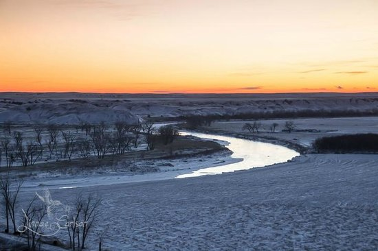 Circle View Guest Ranch: Sunset to the west of the ranch house overlooking the river.