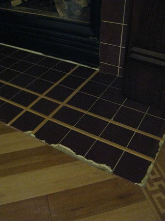 Three Chimneys Inn: Tiles at base of fireplace