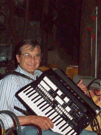 Il Ristoro degli Dei: Father playing accordion