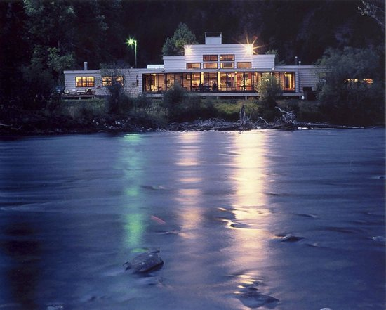 The Complete Fly Fisher: View of the main lodge from across the Big Hole river of the dining area and rooms on either end
