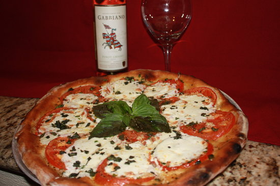 Ciao Wood Fired Pizza and Trattoria: Margarita Pizza made with our from scratch mozzarella and roma tomato...in our Wood Fired oven