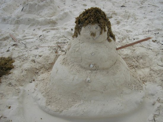 The Reef Coco Beach: Snow man sand sculpture