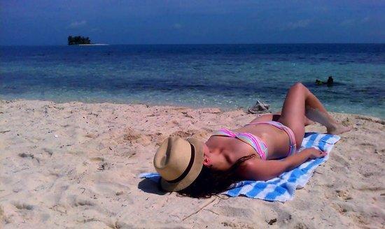 Robert's Grove Beach Resort: Tanning on Silk Caye Island during Snorkeling