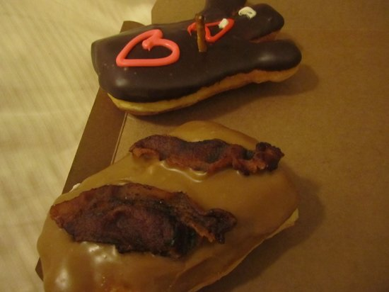 Voodoo Doughnut: One maple bacon (YUM) and the classic 'voodoo' with a pretzel steak through the heart.