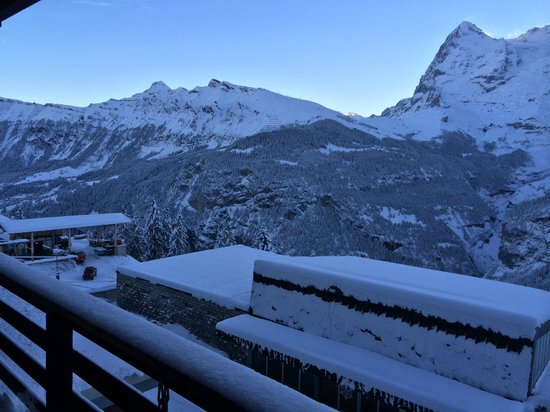 Hotel Eiger: View from balcony: Eiger on right, station below, Wengen far left.