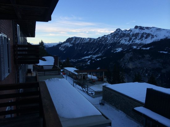 Hotel Eiger: Early morning view from balcony, down the valley, Wengen on opposite side of valley