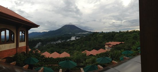The Springs Resort and Spa: Panoramic shot of Arenal volcano from the open-air lobby.