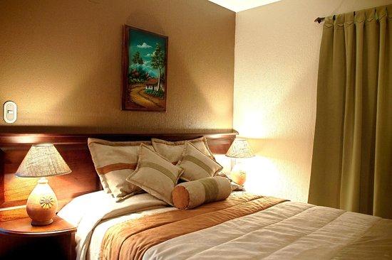 Hotel & Spa Poco a Poco: Confortable beds and rooms.