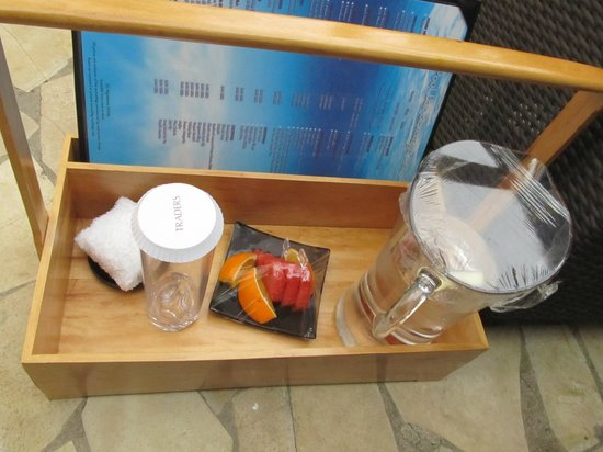 Sule Shangri-La Yangon: Water, fruit and cold towel waiting for me after a swim