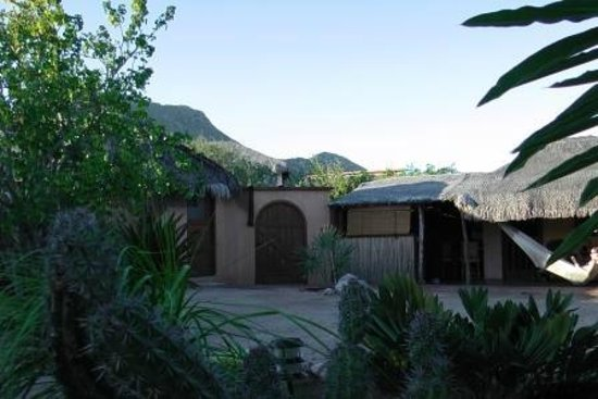 Baja Bungalows: Courtyard entrance with kitchen on right and bathroom on left