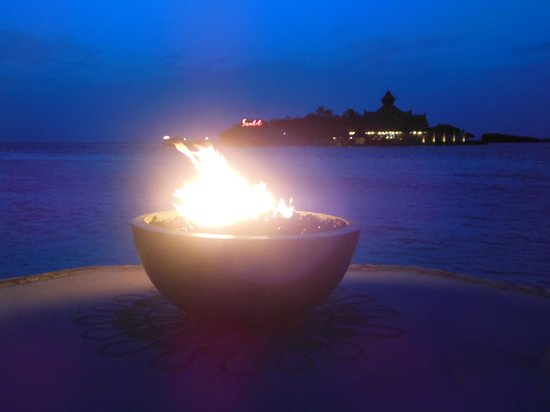Sandals Royal Caribbean Resort and Private Island: fire pit at night waiting for boat to Thai on the island