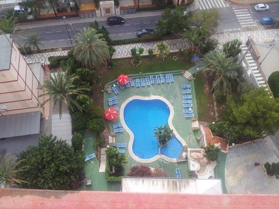 Apartamentos El Faro: looking down to pool area