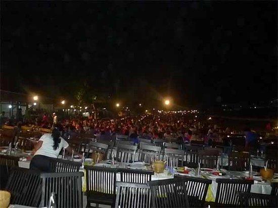 Romantic Dinner in Jimbaran Bay: Rows of dining chairs along Jimbaran seaside