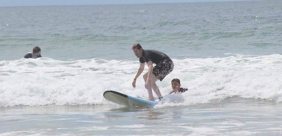 Point Break Surf School: Hubby getting up on his board!