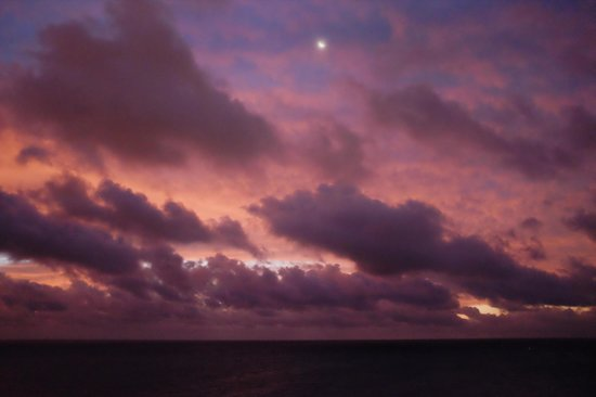 Grand Lucayan, Bahamas: The sunrises as the moon sets.  From the 10th floor room.