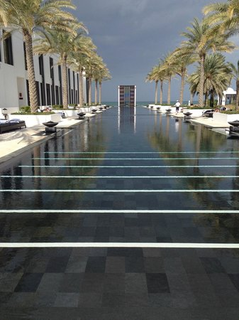 The Chedi Muscat – a GHM hotel: The Long Pool (103 m).  Chairs on the sunny side are taken by 8:30 am during high season - be ea