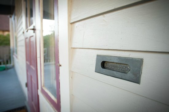1899 Inn: The house retains a number of original hardware features, such as this vintage mail slot.