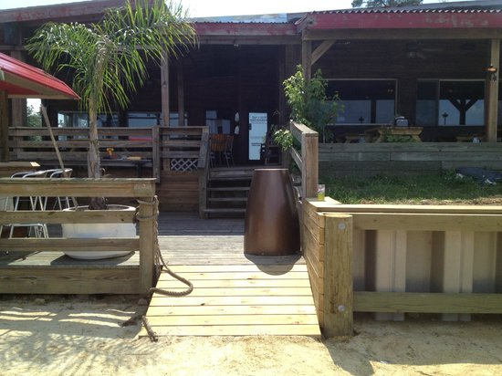 The Landing Restaurant and Waterfront Bar: The Sand Patio and Tiki Bar