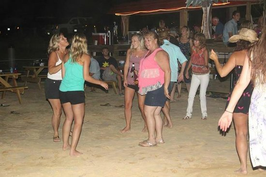 The Landing Restaurant and Waterfront Bar: Dancing to Live Music on the Sand Patio