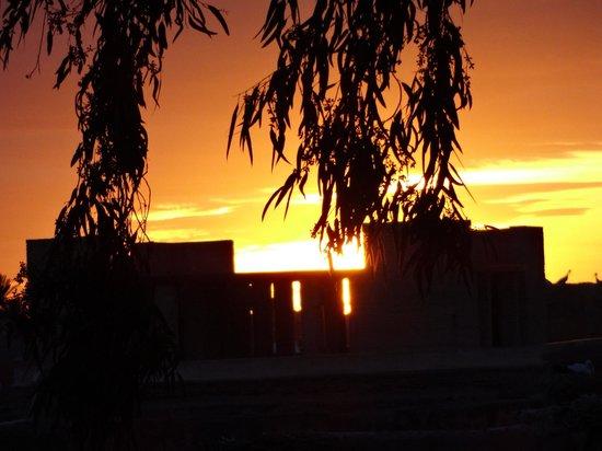 Kosy Bar : Sunset from KosyBar across Bahia Palace