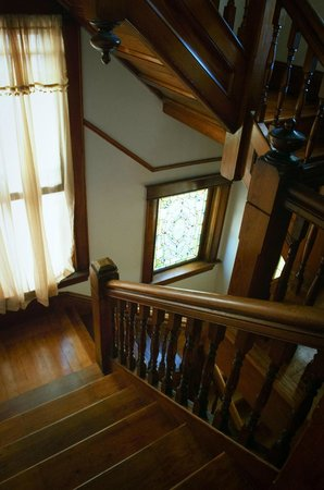 1899 Inn: The home's fir and oak trim is especially visible on the main staircase.
