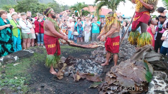 Chief's Luau: The feast being removed form the pit